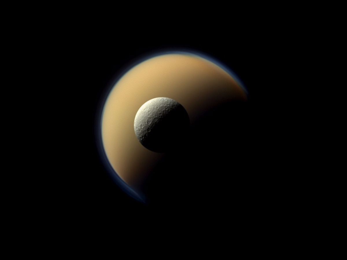 This shot shows Saturn's second-largest moon, Rhea, eclipsing Titan.