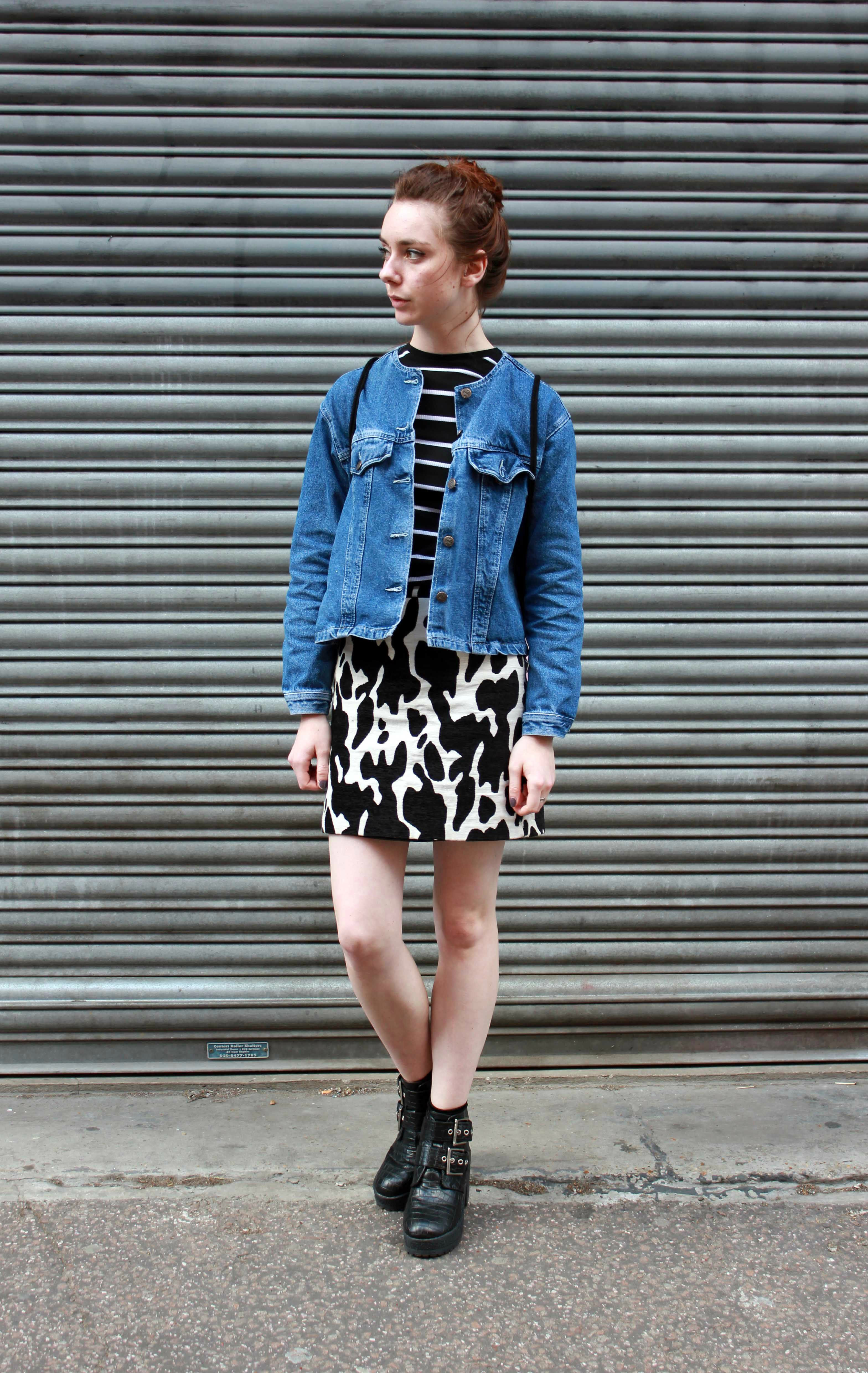 Vintage denim jacket, a cow print skirt and black boots worn by fashion and style blogger Chelsea Jade