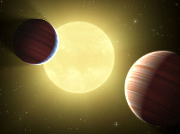 An artist's concept of two exoplanets orbiting the same star, as discovered by the Kepler spacecraft.