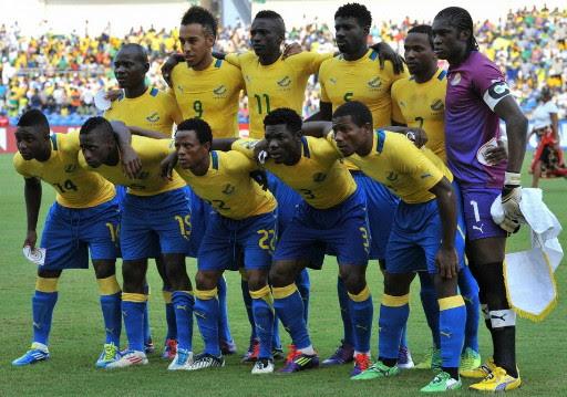 Gabon-12-PUMA-home-kit-yellow-blue-blue-line-up.jpg