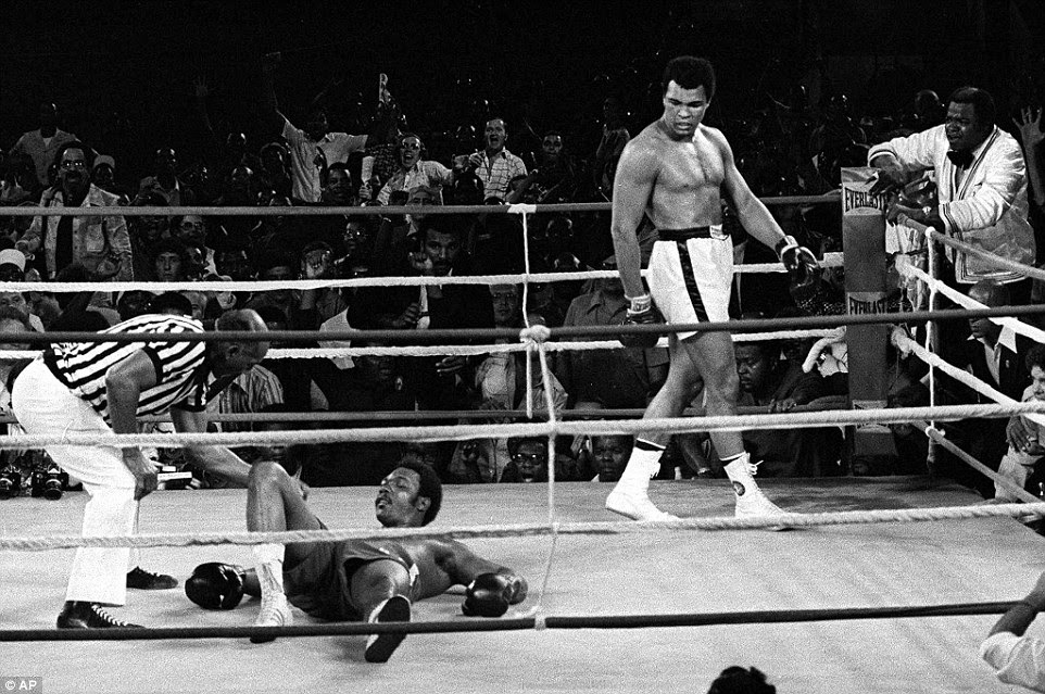 Ali prowls the ring after putting George Foreman down in round eight of the Rumble in the Jungle in Zaire in 1974