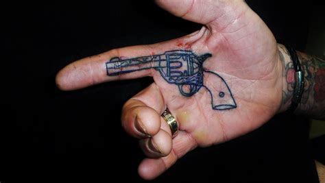 small gun tattoo handjpg gun tattoo