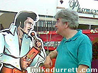 Photo: Elvis Presley and Mike Durrett catch up.