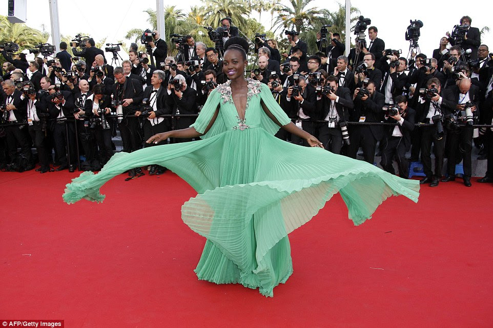 Green goddess: Lupita Nyong'o made an incredible statement as she arrived on the red carpet in her mint coloured Gucci gown