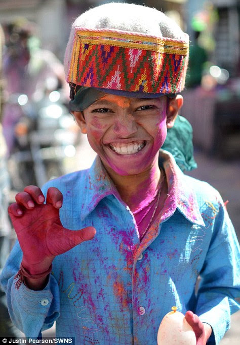 A young boy in action for the Holi Festival in Udaipur, India