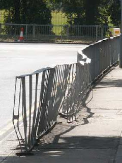 mangled railing opposite Claybury Broadway