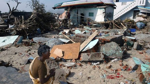 A file picture dated 30 December 2004 shows a woman sitting among the ruins of her destroyed house in Nagapattinam, Tamil Nadu, India.