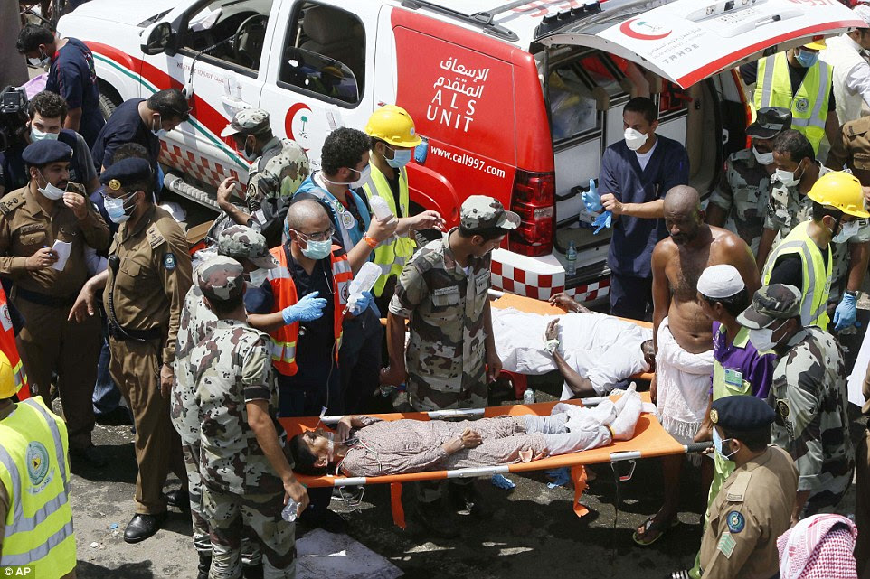 Emergency service workers attend to victims crushed in the stampede in Mina, Saudi Arabia, during the annual Hajj pilgrimage on Thursday