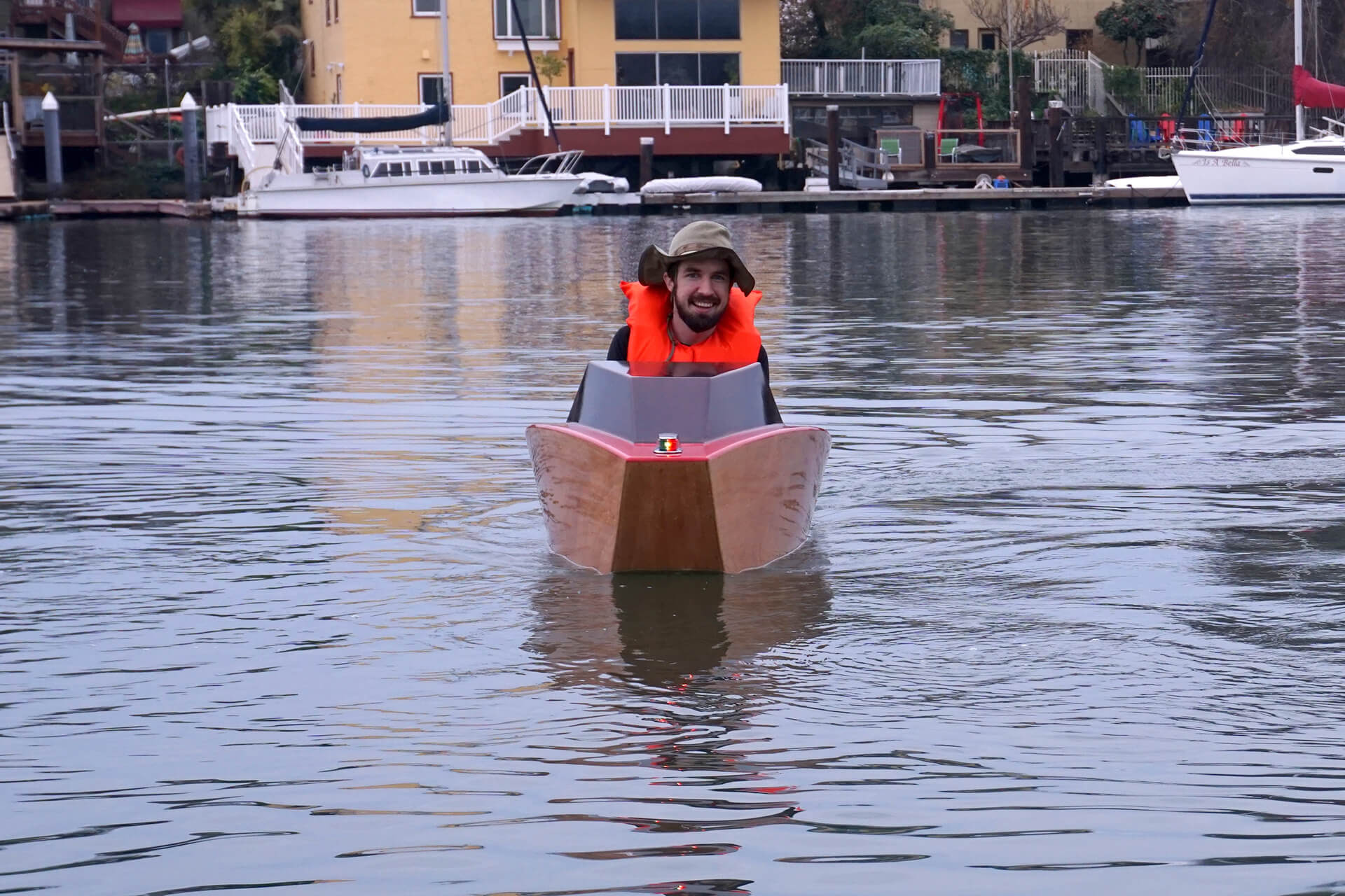 Josh racing towards the camera at the first launch of the mini electric boat