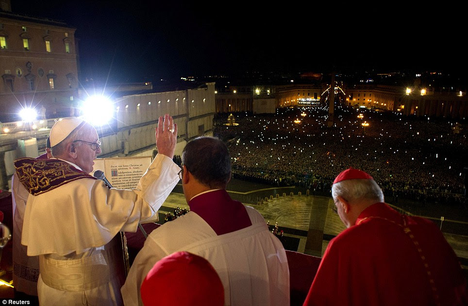 A leader's view: Newly elected Pope Francis I appears on the balcony of St. Peter's Basilica after being elected by the conclave of cardinals