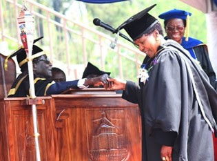 Republic of Zimbabwe Minister of Community Development and Gender Oppah Muchinguri receives masters degree in international relations at the University. She is congratulated by President Mugabe on September 13, 2013. by Pan-African News Wire File Photos