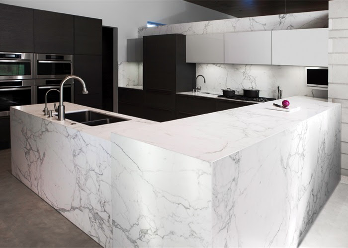 L shape white marble countertop with deep square sink and faucet an electric stove elegant top kitchen cabinets and modern appliances of kitchen