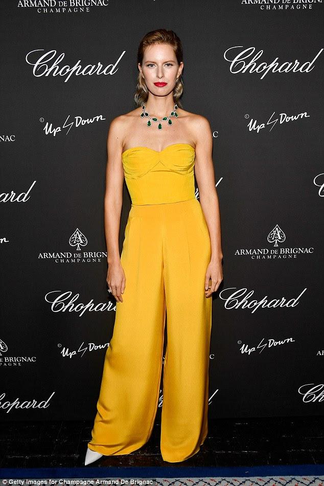 Mellow: Karolina Kurkova looked magnificent in an all yellow ensemble