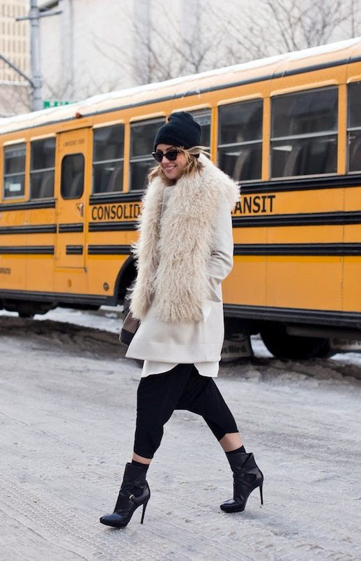 LE FASHION BLOG NYFW FW 2014 STREET STYLE KELLY FRAMEL THE GLAMOURAI WINTER LOOK CAT EYE SUNGLASSES BLACK BEANIE HAT OFF WHITE COAT WITH MONGOLIAN FUR SCARF COLLAR BLACK DROP CROTCH HAREM PANTS BLACK HEEL ANKLE BOOTS BOOTIES WITH BUCKLE VIA CRAIG AREND FOR NEW YORK TIME BLOGGER STYLE photo LEFASHIONBLOGNYFWSTREETSTYLETHEGLAMOURAIDROPCROTCHHAREMPANTS.jpeg