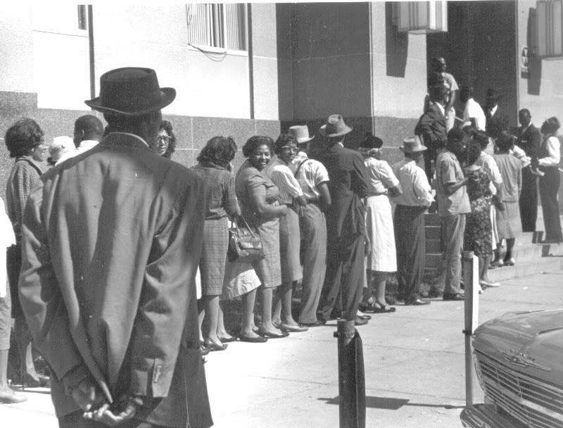 """""""Freedom Day"""" in Selma, October 1963. Blacks line up at the courthouse to apply to register to vote. (c) John Kouns."""