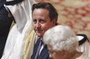 Britain's Prime Minister David Cameron listens to Queen Elizabeth deliver a speech at a State Luncheon for United Arab Emirates President Sheikh Khalifa bin Zayed al-Nahayan in Windsor