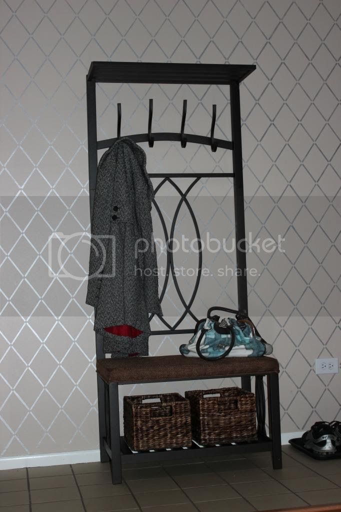 Coat Rack and Bench against Stenciled Wall
