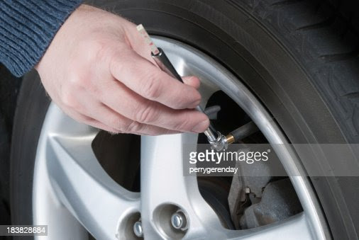 Car Maintenance Check Tire Air Pressure Stock Photo