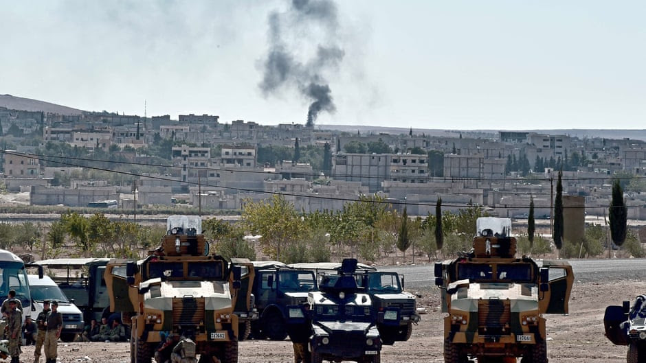 Smoke rises from the Syrian town of Kobane