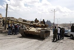 Syrian regime forces celebrate after taking control of a village in the Qalamoun mountains, northeas