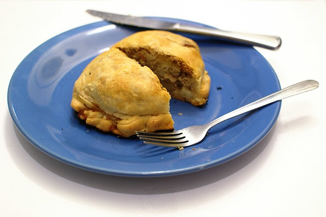 A cornish pasty on a plate.