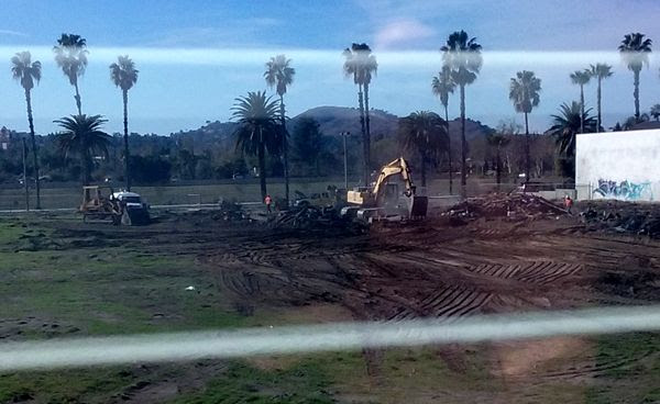 The demolition crew begins cleaning up the area where the old abandoned house once stood on a vacant dirt lot behind my home in Pomona, CA...on January 26, 2018.