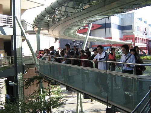 Audiences watching the street performer