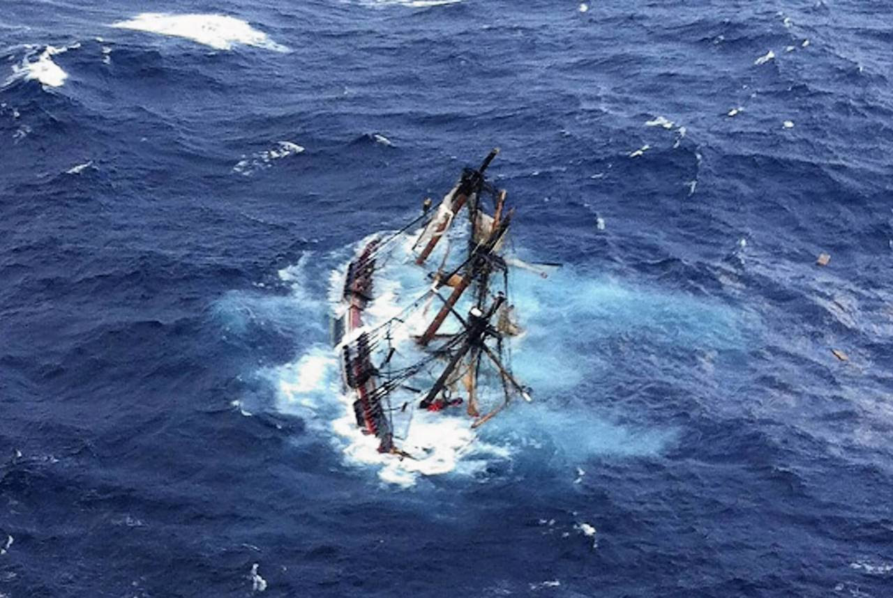 The HMS Bounty, a 180-foot sailboat, is submerged in the Atlantic Ocean during Hurricane Sandy approximately 90 miles southeast of Hatteras, North Carolina. Of the 16-person crew, the Coast Guard rescued 14, recovered a woman who was later pronounced dead and are searching for the captain. The HMS Bounty was built for the 1962 film Mutiny On The Bounty and was also used in Pirates Of The Caribbean.