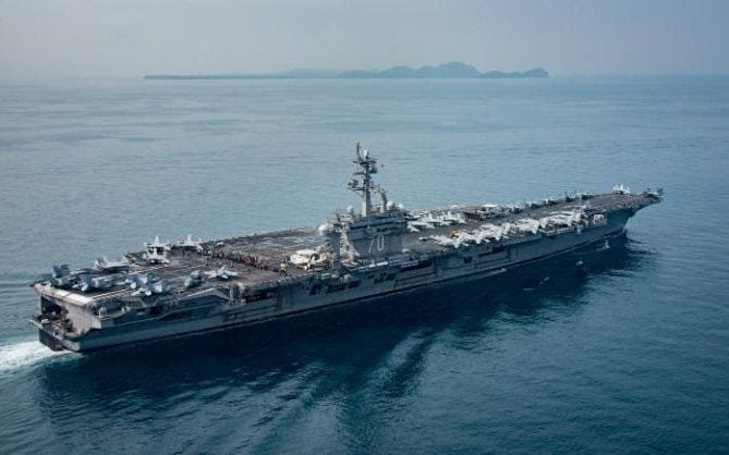 The aircraft carrier USS Carl Vinson transits the Sunda Strait in an image released on April 15