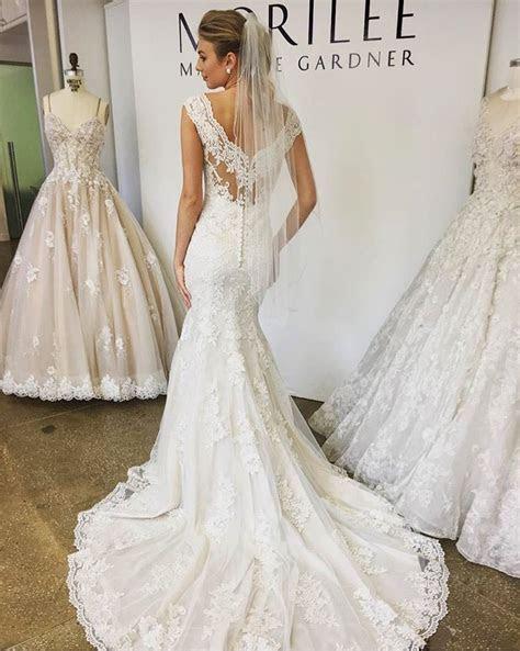 Lace fitted mermaid fishtail wedding dress with low lace
