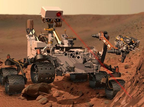 An artist's concept of the Curiosity Mars rover firing its ChemCam laser at a rock.