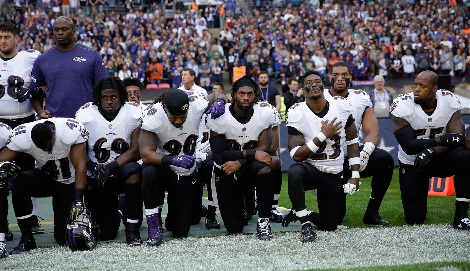 http://static1.businessinsider.com/image/59c7b82819d2f51e008b524c-1592/baltimore-ravens-kneel-for-anthem.jpg
