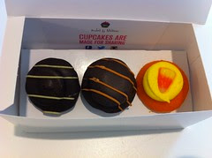 Chocolate covered and candy corn mini cupcakes from Baked by Melissa! by Rachel from Cupcakes Take the Cake