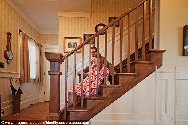 Happy at home: Reclining on the stairs in the Utah home, the hope holds hands and smiles