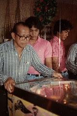 Grandpa Henry playing the pinball machine in Makakilo