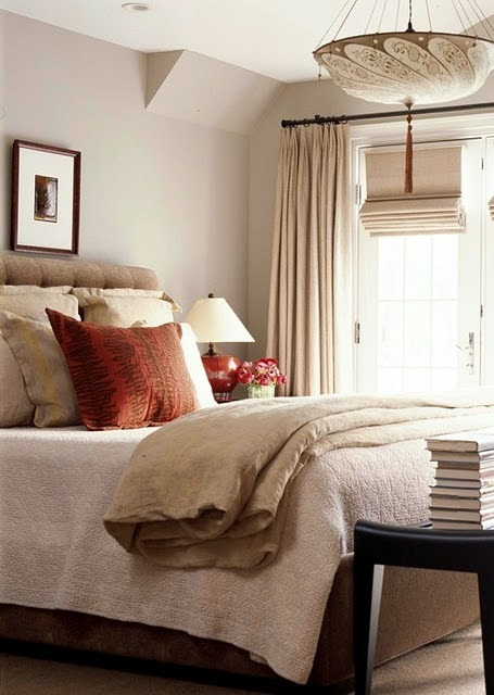 give a neutral room a pop of color with a pillow and/or lamp