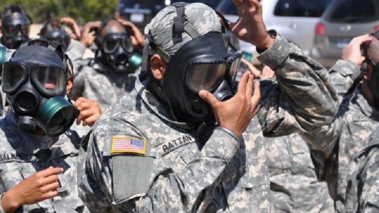 A serving Sikh officer - not Capt. Simratpal Singh - dons a gas mask over his camouflaged turban during a U.S. Army training exercise. (U.S. Army photo by Steve Elliott)