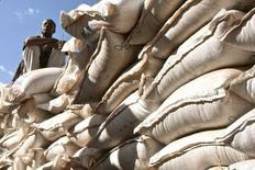 An unidentified government official sits on sacks of wheat donated by the U.S. at a food distribution point near Jijiga, eastern Ethiopia  in a file photo.  REUTERS/Barry Malone