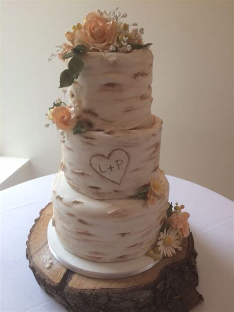 Birch tree wedding cake with sugar daisies and roses