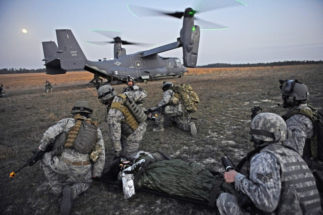 Airmen load a simulated casualty into an Air Force V-22 during a March exercise in Florida. Photo: Air Force