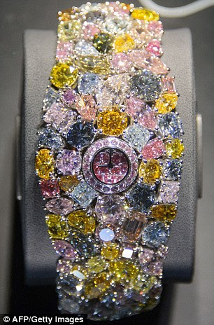 The spectacular Graff Hallucination, designed by London jewellers Graff Diamonds, is a 110-carat watch coated in colourful rare diamonds