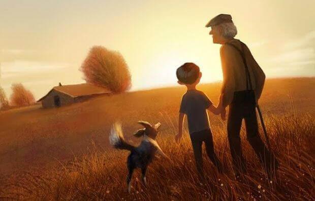 grand-pere-se-promenant-avec-ses-petits-enfants