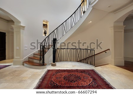 Large Foyer In Luxury Home With Circular Staircase Stock Photo ...