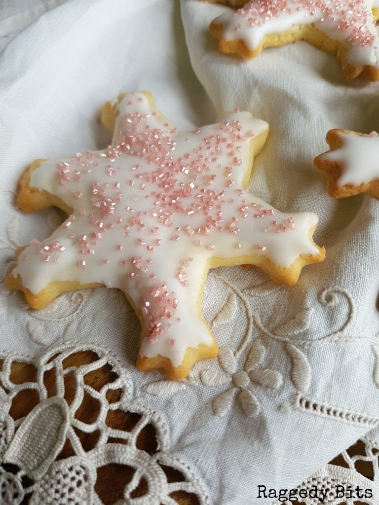 Add some sparkle to your gift giving or Christmas Baking this year and make these cute Pink Sparkle Snowflake Cookies | Printable Recipe | www.raggedy-bits.com