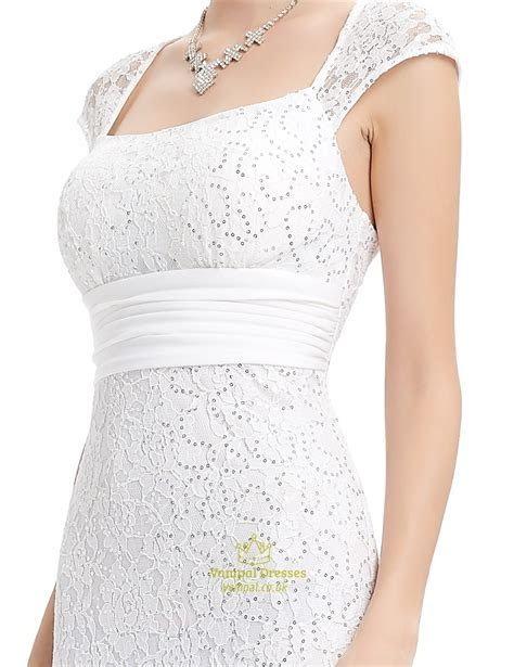 Ivory Lace Sheath Wedding Dress With Cap Sleeves And Open