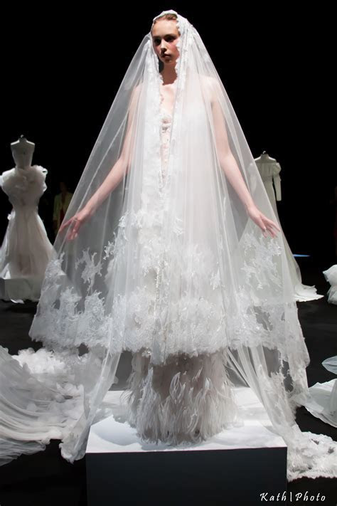 East meets West ? LAN YU debuts bridal collection at