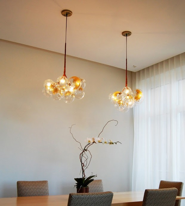 Mid century modern brass chandeliers for a hospitality ...