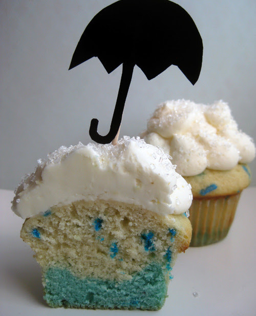 Rainy day cupcakes! I couldn't bake real rain into a cupcake, but some blue food coloring and sprinkles almost do the trick! To make your own, just add a couple drops of blue food coloring or food gel to 1/3 of your favorite vanilla cake batter....