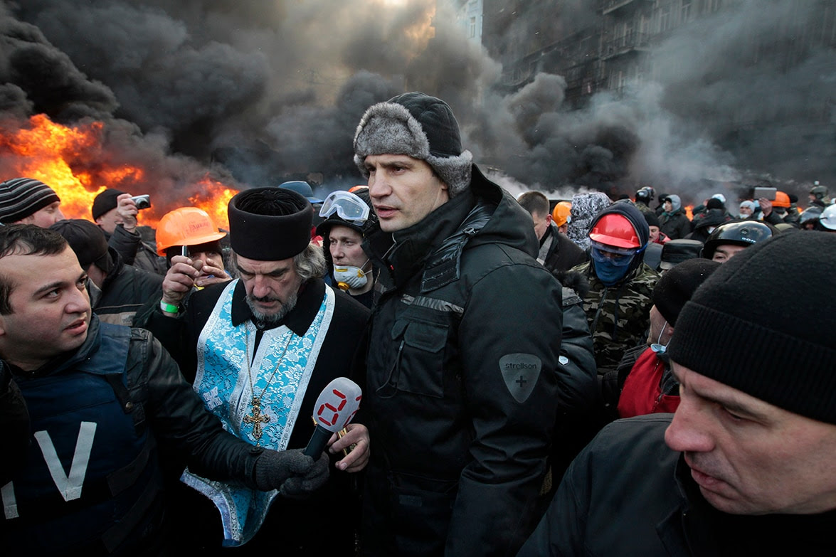 Opposition leader and former boxing champion Vitali Klitschko speaks with protesters. (Sergei Chuzavkov/AP)