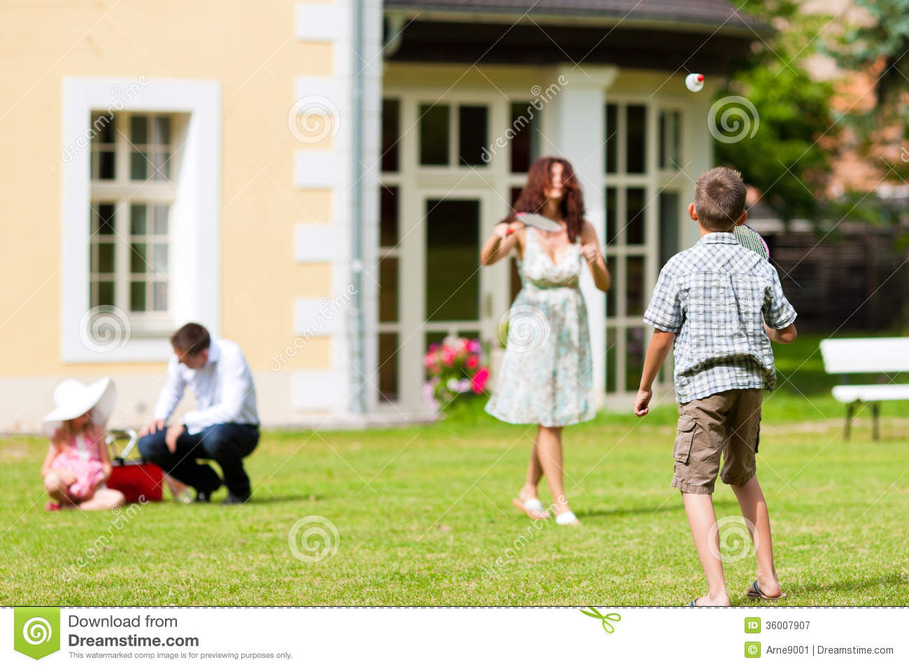 Family Is Playing In Summer In Front Of Their House Royalty Free ...